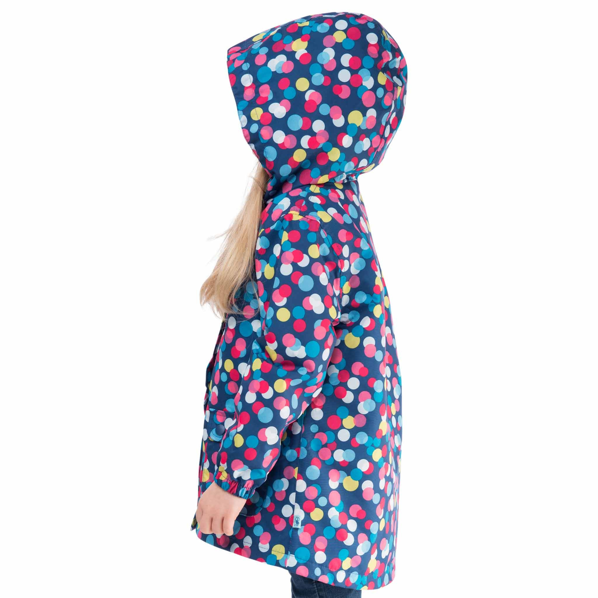 Carrie Girls Waterproof Hooded Jacket, in Washed Navy Polka Dot, Modelled Side View | Lighthouse