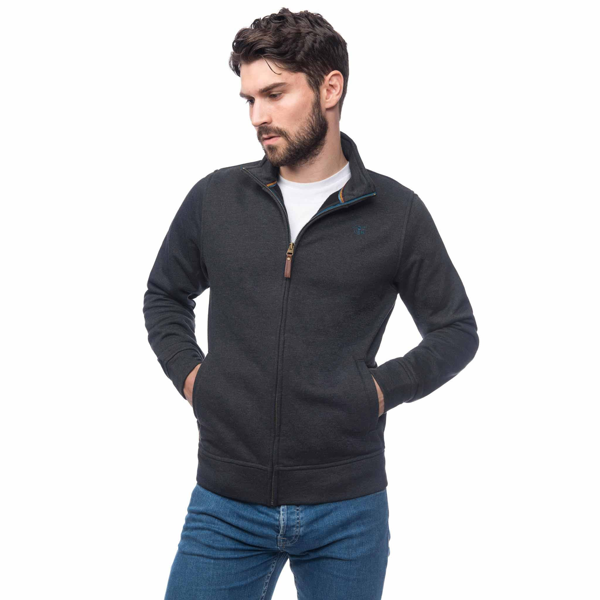 Lighthouse Mens Cove Jersey Top in Grey. Half zipped, hands in pockets.
