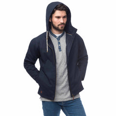 Lighthouse Mens Faroe Waterproof Jacket in Navy. Hood up. Upzipped and hands in pockets.