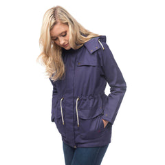 Lighthouse Lana Womens Waterproof Hooded Raincoat in Purple. Zipped and buttoned. Hands in pockets.