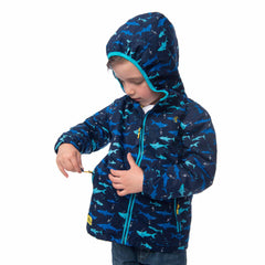 Lighthouse Boys' Ollie Fleece Lined Waterproof Hooded Raincoat in Navy with Shark Print. Fully Zipped. Hood Up. Showing Pocket Zip Tab.