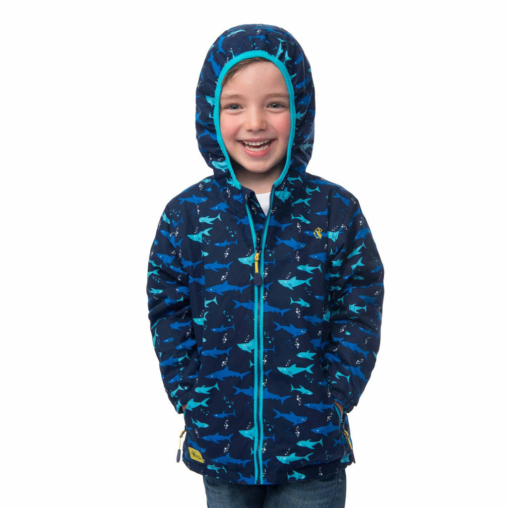 Lighthouse Boys' Ollie Fleece Lined Waterproof Hooded Raincoat in Navy with Shark Print. Fully Zipped. Hood Up.