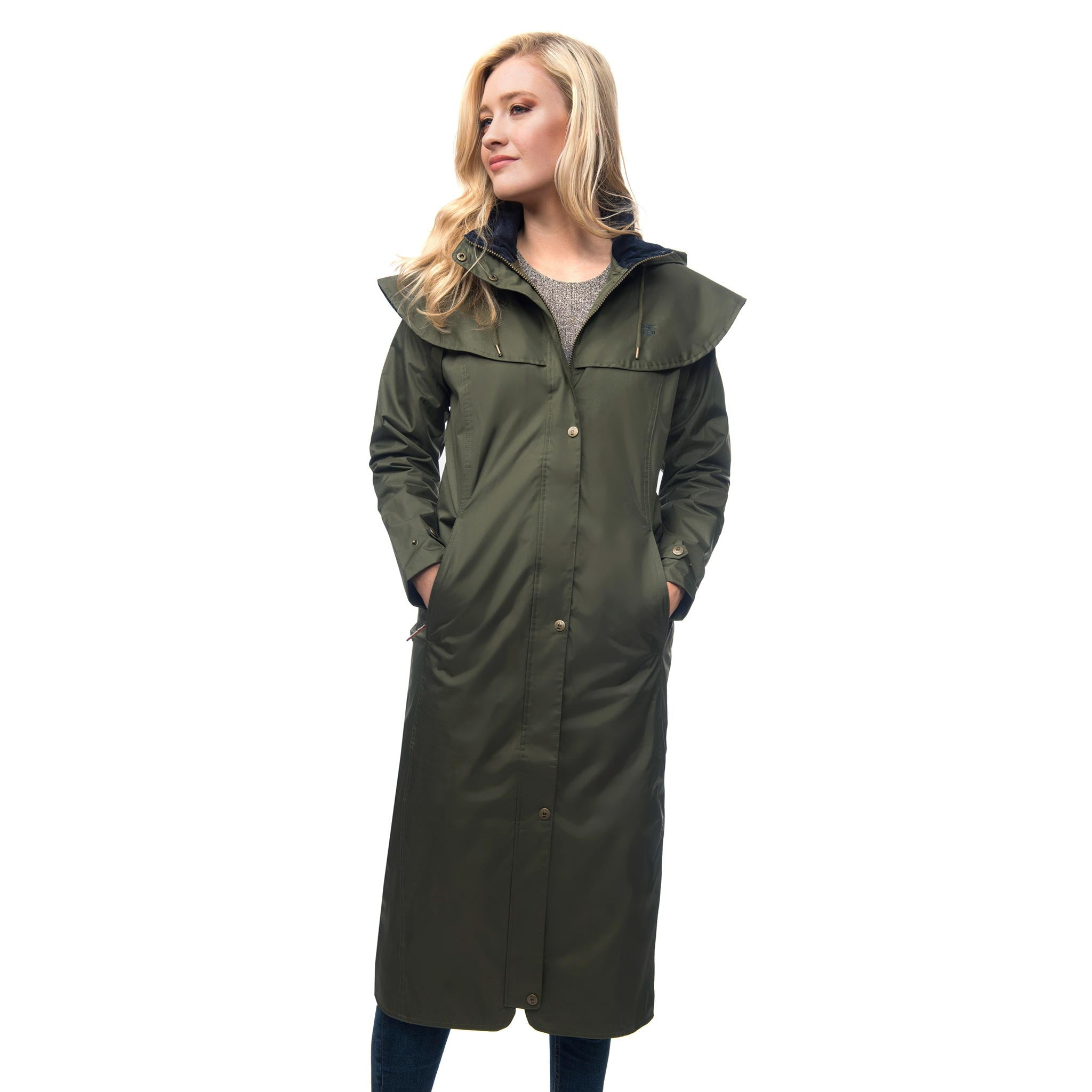Lighthouse Womens Outback Full Length Waterproof Raincoat in Green. Zipped and buttoned. Hands in pockets.