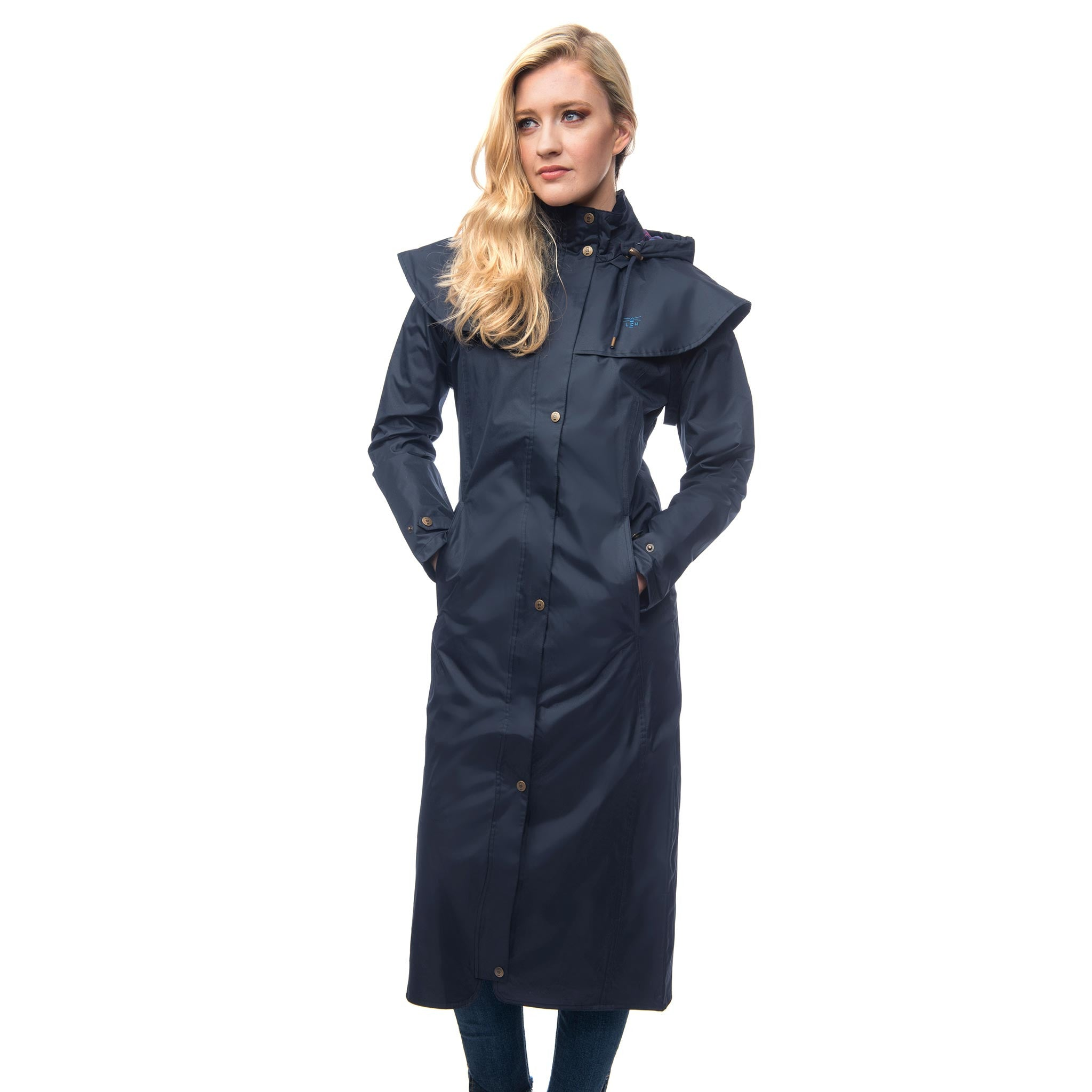 Lighthouse Womens Outback Full Length Waterproof Raincoat in Navy. Zipped and buttoned. Hands in pockets.