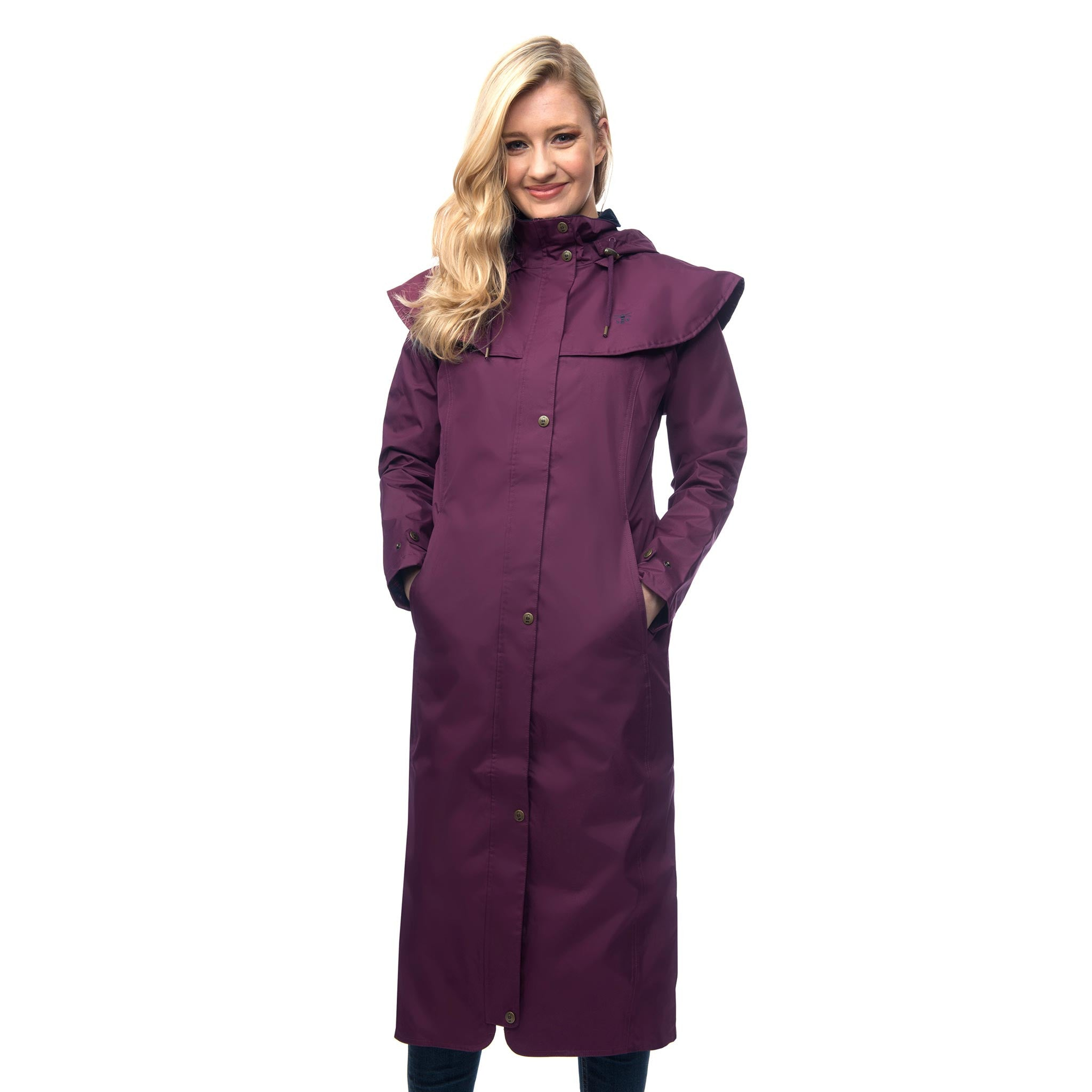 Lighthouse Womens Outback Full Length Waterproof Raincoat in Purple. Zipped and buttoned. Hands in pockets.