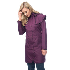 Lighthouse Womens Outrider 3/4 Length Waterproof Raincoat in Purple. Zipped & Buttoned. Hands in pockets.Hood Down. Cape