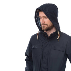 Rigger Mens Waterproof Jacket with Cotton Outer, in Ink Navy, Modelled Side View | Lighthouse
