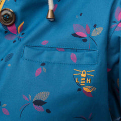 Lighthouse Siena Womens Waterproof Hooded Jacket in blue. Button detail shot.