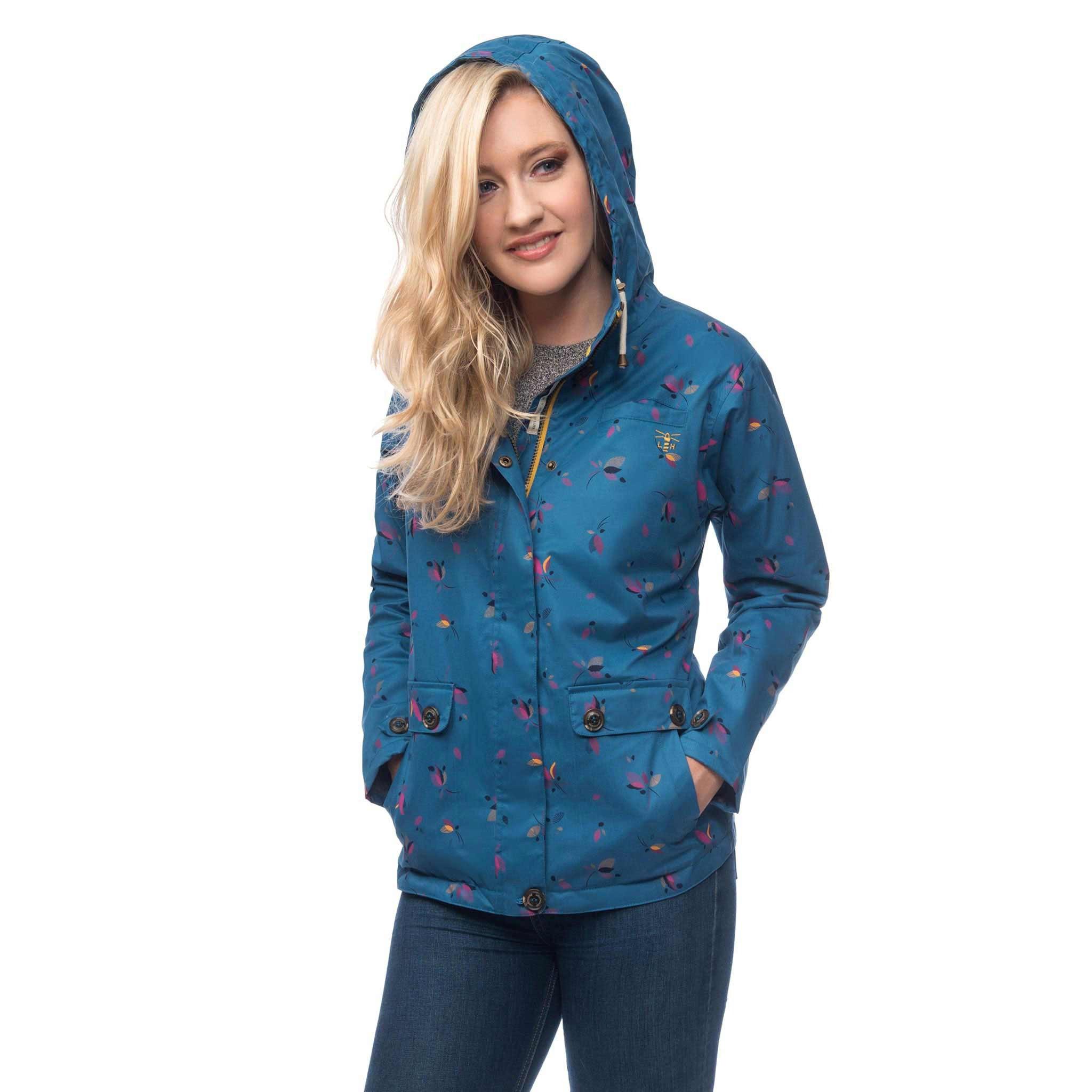 Lighthouse Siena Womens Waterproof Hooded Jacket in blue. Zipped & Buttoned. Hood up. Hands in pockets.