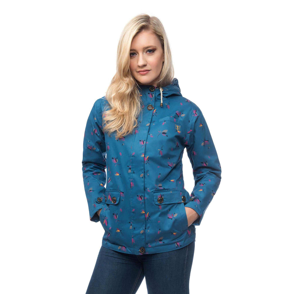 Lighthouse Siena Womens Waterproof Hooded Jacket in blue. Zipped & Buttoned. Hood Down. Hands in pockets.
