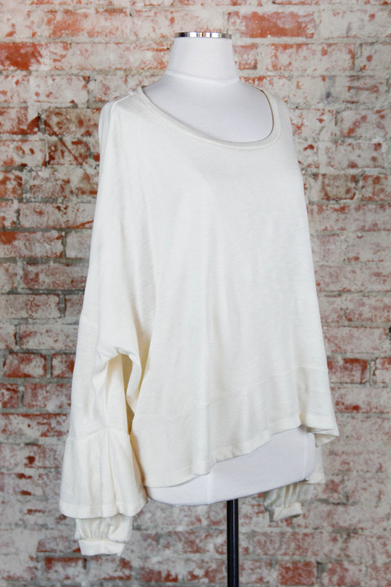 Cream Ruffled Sleeves