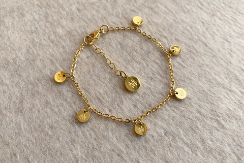SIGNATURE GOLD STAINLESS STEEL BRACELET