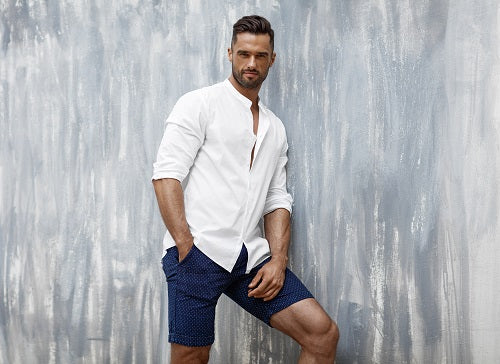 Handsome man in fashionable shorts