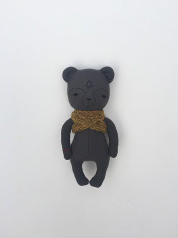 woolen bear soft toy – dark grey with yellow scarf