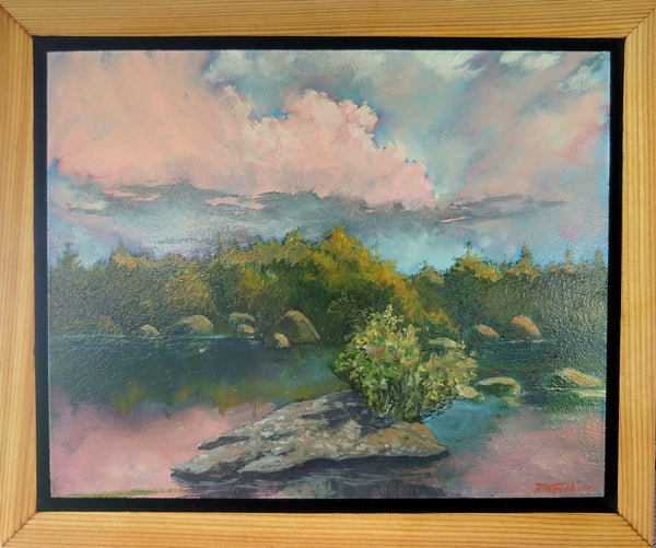 """Ethan Pond Sunset"" is a framed 8 by 10 inch oil painting on panel, depicting a mountain pond with trees along its edge and rocks in the water. Pink sunset clouds are reflected in the water. Ethan Pond is in the White Mountain National Forest in New Hampshire. This view shows the painting in its frame."