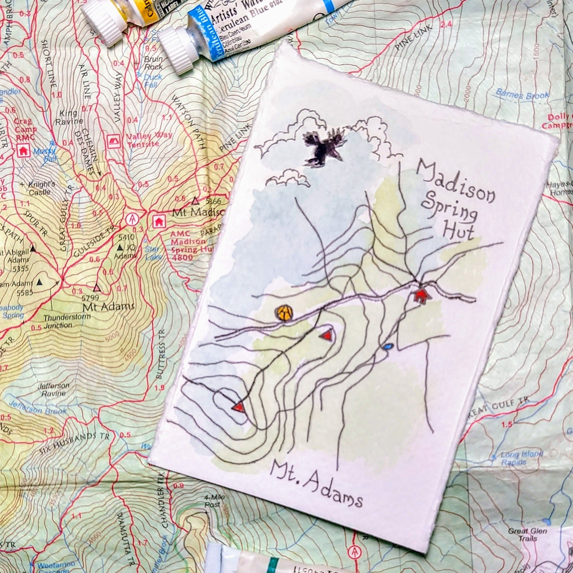 """Mount Adams and Madison Spring Hut,"" one of my miniature map paintings. These small watercolor paintings are tiny artworks of my favorite trails in the White Mountains of New Hampshire, home of some of the Northeast's best hiking!"