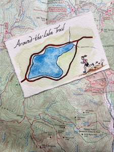 """Around the Lake Trail,"" one of my miniature map paintings. These small watercolor paintings are tiny artworks of my favorite trails in the White Mountains of New Hampshire, home of some of the Northeast's best hiking!"
