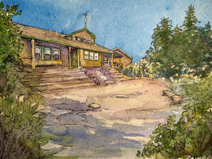 """Zealand Falls Hut, White Mountains, NH"" is a 9 by 7.25 inch watercolor and ink painting on paper by Rebecca M. Fullerton, depicting one of the Appalachian Mountain Club's eight backcountry huts of the White Mountains of New Hampshire. The cozy hut is tucked among trees with blue skies above."
