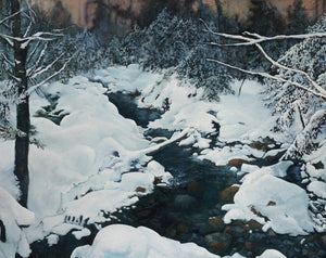 """Crawford Brook in Winter"" can be purchased as a 16 by 20 inch fine art print. It depicts the deep winter woods with the dark waters of a partially-frozen stream running through them. Bright white snow covers the many shoreline rocks and boulders and traces each tree branch."
