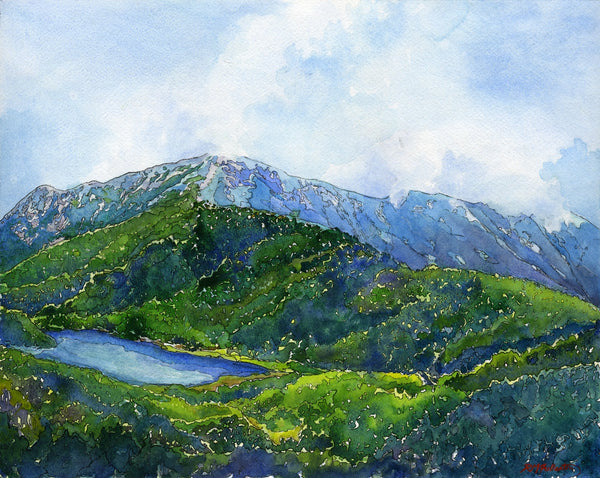 """Mount Lafayette, New Hampshire"" is a 14 by 11 inch fine art print on paper by Rebecca M. Fullerton, depicting the summit of Mount Lafayette in spring, seen from Greenleaf Hut. Bright early greens of trees coming into leaf frame the blue and purple granite rock of the summit. The clear blue waters of Eagle Lake are tucked into the foreground. Soft clouds and mist skim overhead."