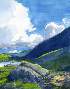 """Alpine Light"" is a 16 by 20 inch watercolor and ink painting on paper by Rebecca M. Fullerton, depicting Star Lake, the slopes of Mount Adams, and glimpses of the Presidential Range in the White Mountain National Forest of New Hampshire. Huge white clouds move over blue mountains, green alpine plants and craggy granite boulders on the edge of a mountain pond."
