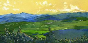 """Across the Valleys"" is a 4.5 x 9 inch watercolor and ink painting on paper by Rebecca M. Fullerton, depicting the view from Mount Hunger over the hills and valleys of Vermont all the way to Camel's Hump in the distance. The sky is a golden yellow of sunset hues while the land below is painted in greens and blues."