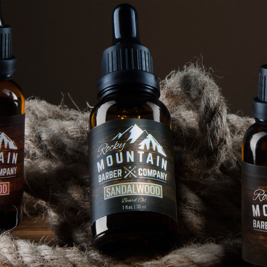 Rocky Mountain Barber Sandalwood Beard Oil Group Shot Lying Down
