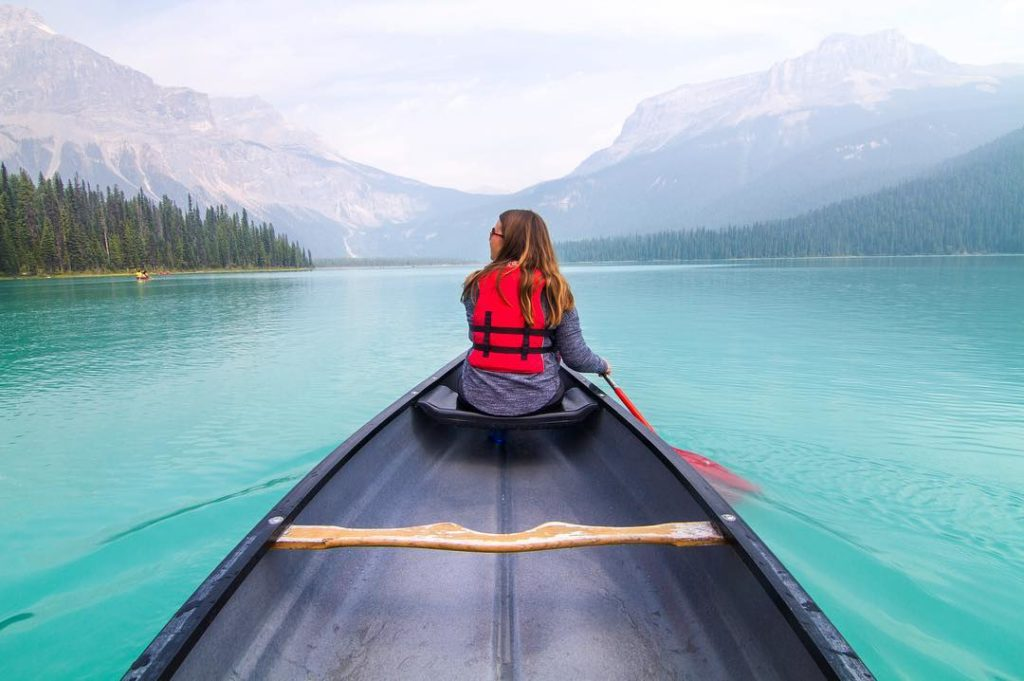 Sarah Taggart - Tiny Van Big Living - Kayaking on blue water