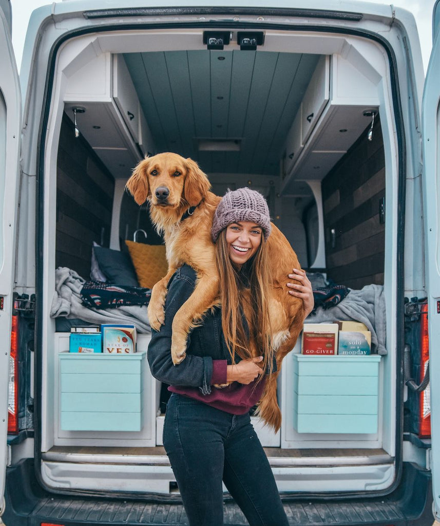Sydney Ferbrache with her dog on her shoulders talks in an interview with maca about her lifestyle in a Van full-time
