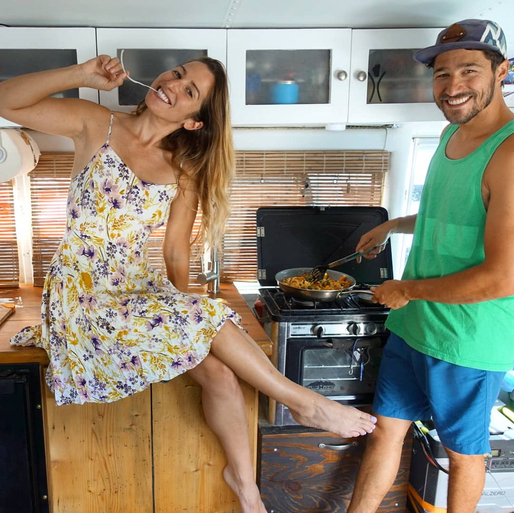 Nick and Jessica cooking in their School Bus Home - Blue bus adventure