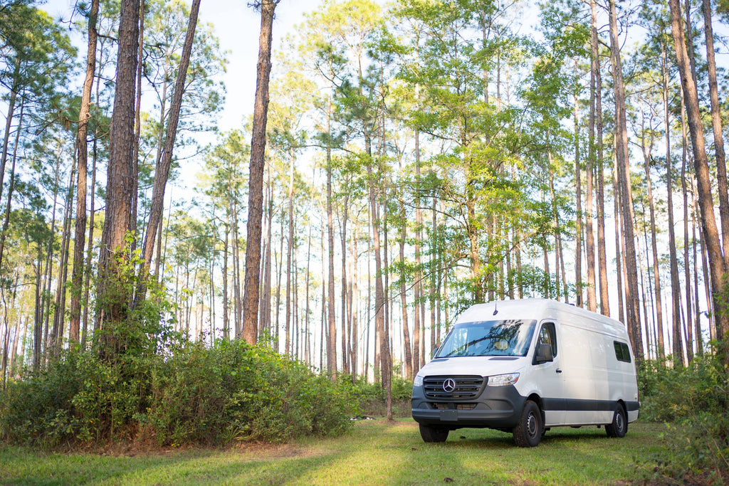 Van outdoors camping in the forest