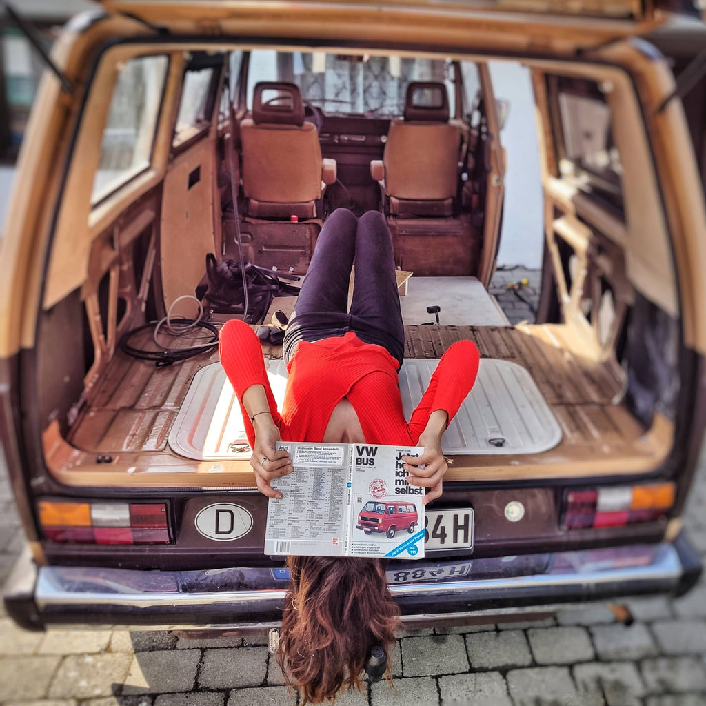 Yurena in the van upside down reading a map