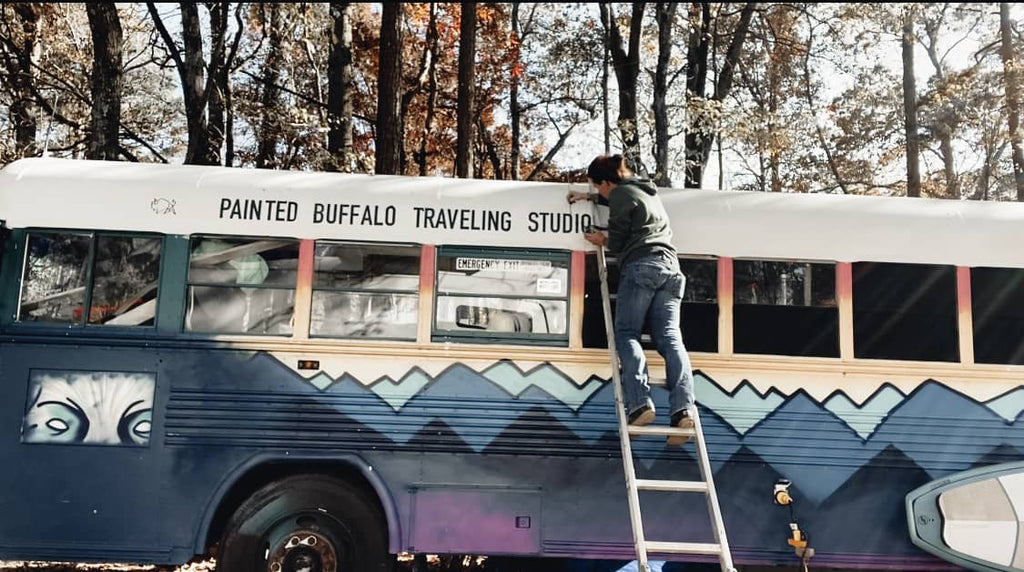 Jessica Rambo painting the outside of her bus