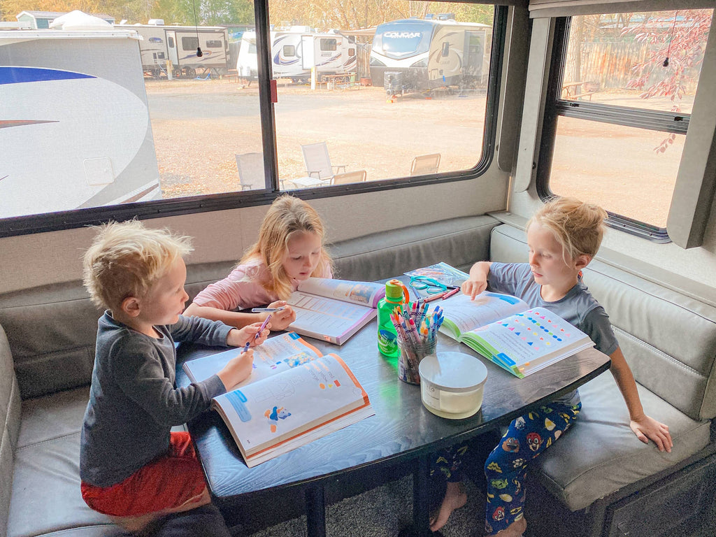 kids homeschooling in the RV