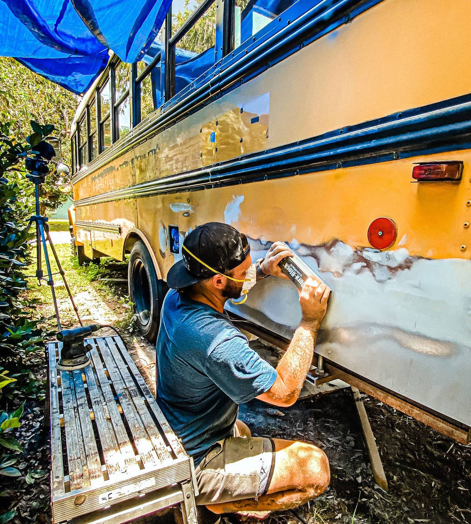 Wes working on the bus conversion, nautical nomads