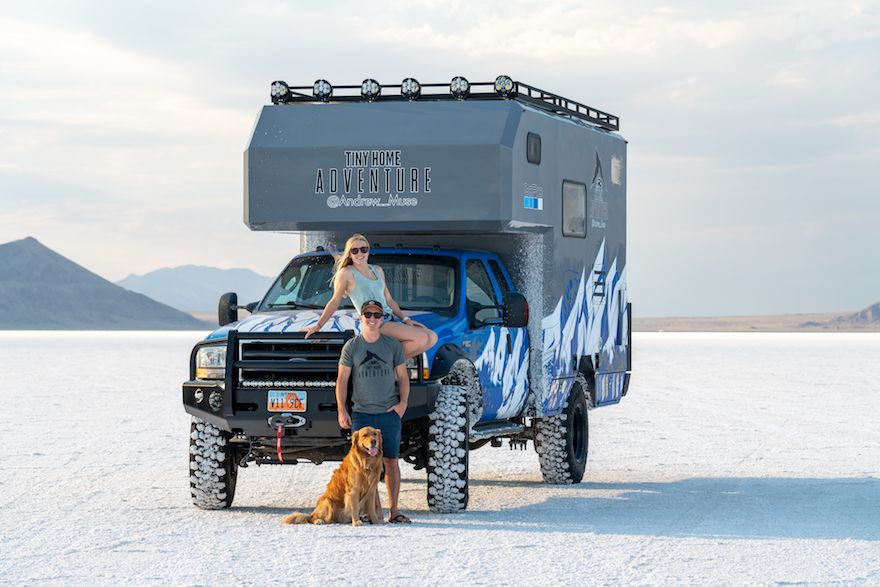 Andrew muse, girlfriend, and booter are outside of their truck camper