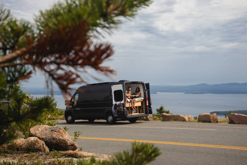 On the road trip photo with van on the road with Katelynn and Ethan at the hunters vanlife