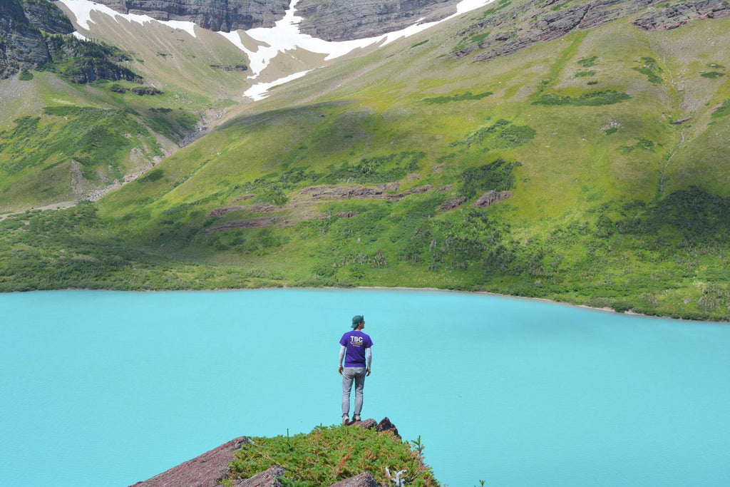 Mikah in a national park on his epic road trip by a lake