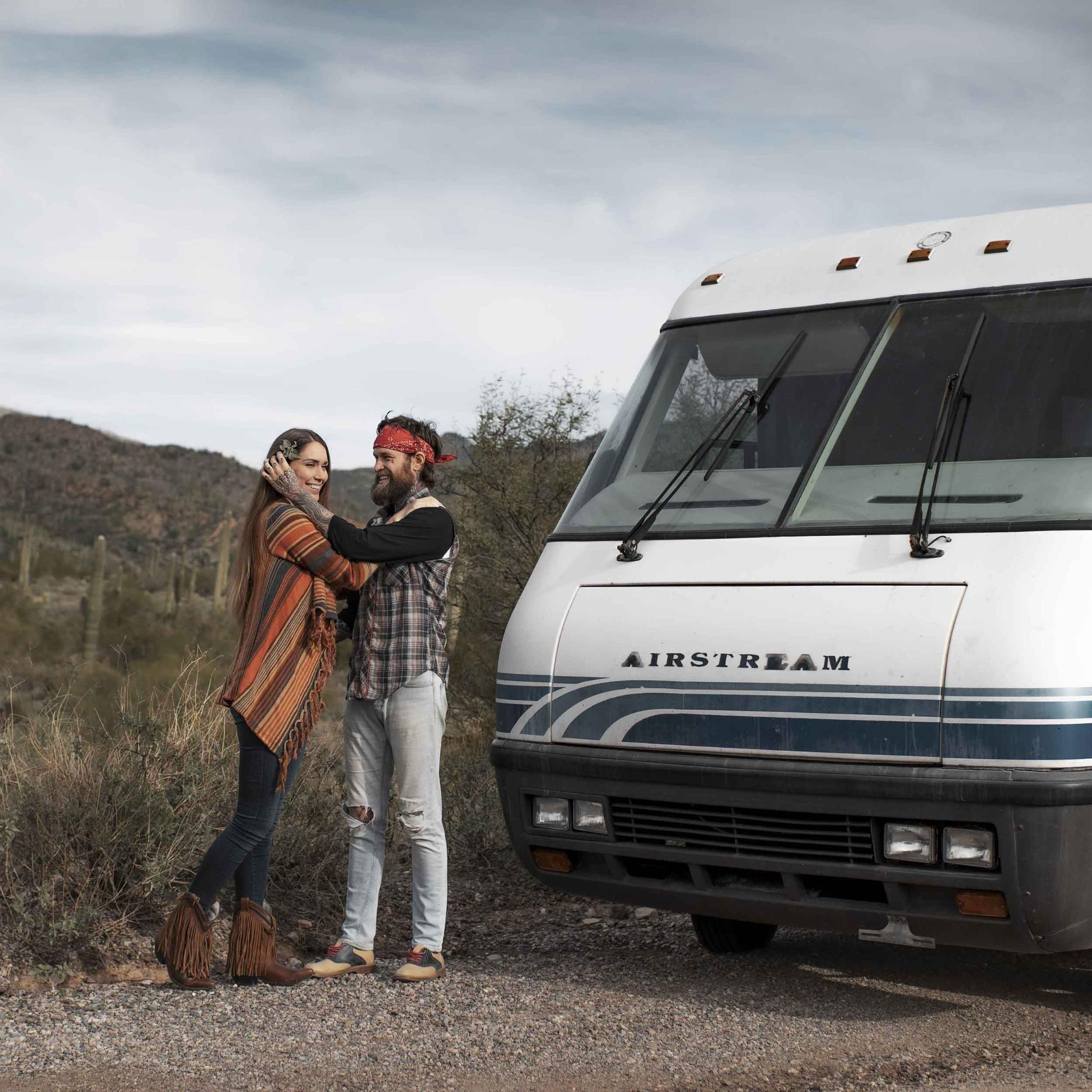 Reggie and Monica next to the RV on the road