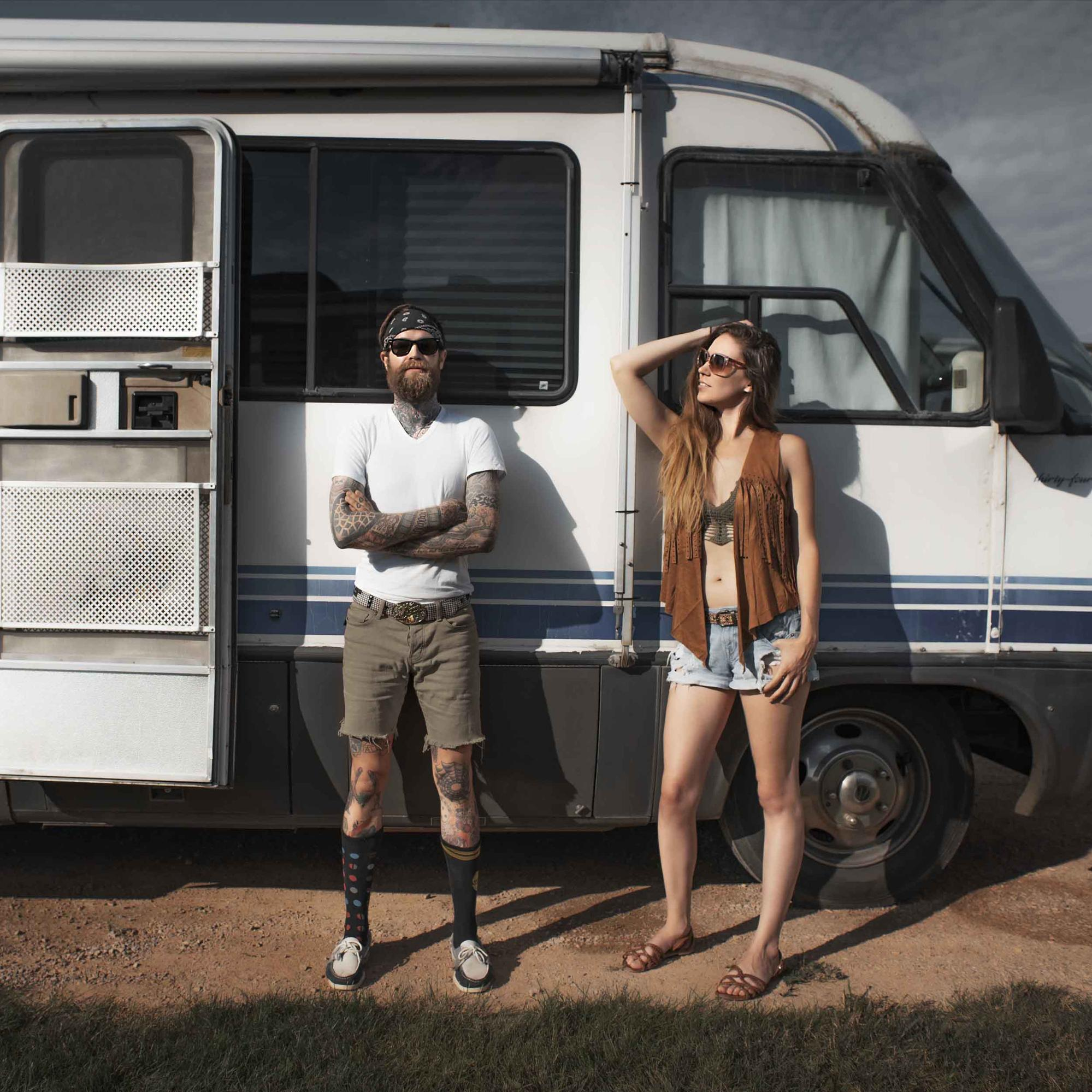 Reggie and Monica standing proud of their Airstream home