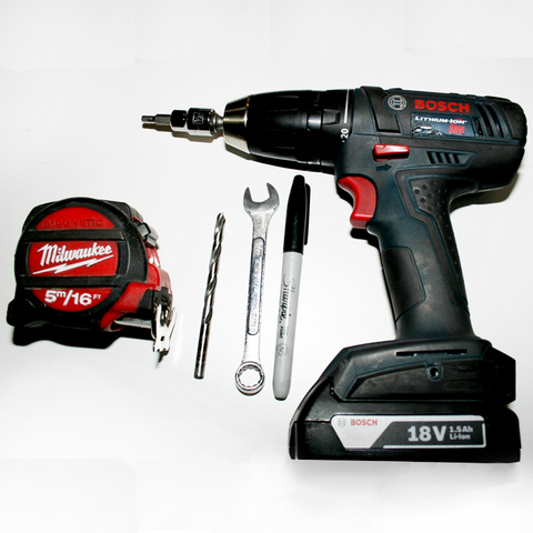 Drill, wrench, sharpie, drill bit measuring tape