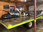Snowbike connected to a flat bed trailer using the Bike Binders securement device