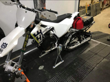 Snowbike securely fastened in the back of a toy hauler using the Bike Binderz securement device