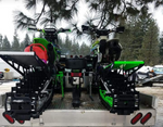 Two snow bikes securely fastened in the back of a flatbed trailer using the Bike Binderz securement device