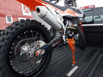 Dirt bike loaded in the flat be of a pick up truck using the Bike Binderz strapless tie down system