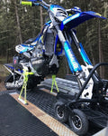 Snow Bike securely fastened to a flat bed trailer with the Bike Binderz strapless tie down system