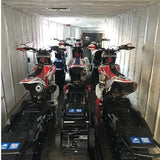 Six snow bikes loaded into an enclosed trailer using the Bike Binderz snowbike kit