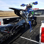 Snow Bike securely fastened in the back of a pickup truck with the Bike Binderz strapless tie down system