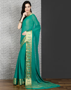 Meena bazaar: Green colour woven saree with stone work