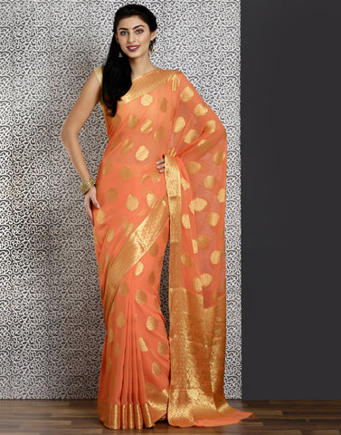 Peach colour woven saree with gold detailing